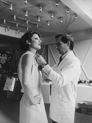 Marc Bohan adjusting a toile over a model