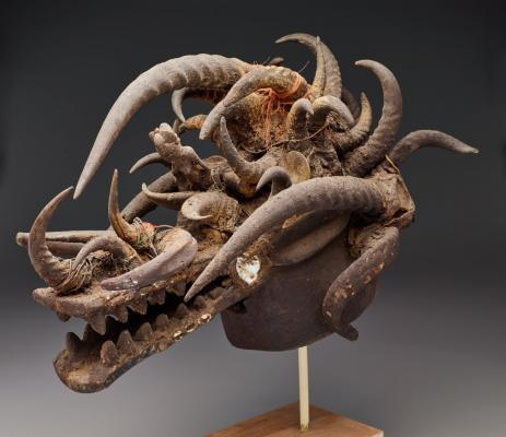 Senufo peoples, helmet mask (komo), mid-20th century, wood, glass, animal horns, fiber, mirrors, iron, and other materials, Dallas Museum of Art, gift of David T. Owsley, 1997.24