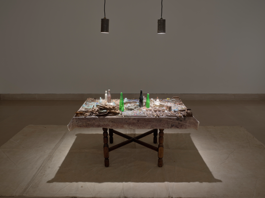 Tracy Hicks, Freedman's Field, 1990-1994, wood table, pottery shards, broken bottles, old watch parts, fragments of porcelain dolls, coins, buttons, oxidized silverware, and rusted metal, Dallas Museum of Art, Charron and Peter Denker Contemporary Texas Art Fund, 2020.14