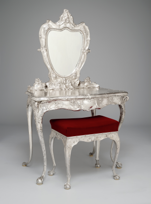 William C. Codman (designer), Joseph Edward Straker (silversmith), Robert Bain (chaser), Carl Lindall (chaser), Christopher Clissold (chaser), Joseph S. Aspin (chaser), Gorham Manufacturing Company, Martelé dressing table and stool, 1899, silver, glass, fabric, and ivory, Dallas Museum of Art, The Eugene and Margaret McDermott Art Fund, Inc., in honor of Dr. Charles L. Venable, 2000.356.A-B.McD